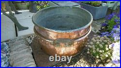 Antique, Victorian, iron and copper cooking pot now a useful log bin or planter