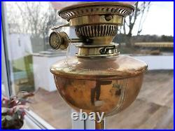 W. A. Benson Oil Lamp with cranberry shade and copper font